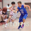 Matt Hamilton/The Daily Citizen<br /> C3 Jake Porter drives down the court as T20 Jared Wigley defends Friday.
