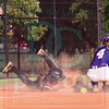 Matt Hamilton/The Daily Citizen<br /> C15 Sierra Dixon hangs on to third base as she slides in and D4 Olivia Adams can't hang on to the ball.