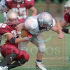Matt Hamilton/The Daily Citizen<br /> Knight's 28 is dragged down by CHS 80 during the 1st quarter Saturday.