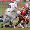 Matt Hamilton/The Daily Citizen<br /> CHS 5 is swarmed by defenders after catching a pass in the flats Saturday.
