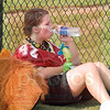 Matt Hamilton/The Daily Citizen<br /> Christian Heritage's Lauren Henley, 18, takes a break from being the school's mascot to cool off with water an a fan Saturday during the school's varsity football game.