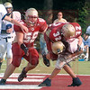 Matt Hamilton/The Daily Citizen<br /> CHS 32 tackles NCA 2 in the backfield