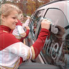 Matt Hamilton/The Daily Citizen<br /> Christian Heritage cheerleaders Hannah Mahoney, front, 17, Bea Brackin, 15, middle, and Emily Suddeth, 16, decorate football player Daniel Groce's car Friday afternoon during the team's final practice.