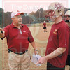 Matt Hamilton/The Daily Citizen<br /> Coach Vaden talks with Andrew Weaver about which man he blocks as the team does a few last minute walkthroughs Friday afternoon.