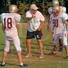 Matt Hamilton/The Daily Citizen<br /> Coach Mike Vaden talks with recievers Michael Land, left, and Viktor Ferraz during practice.