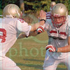 Matt Hamilton/The Daily Citizen<br /> Daniel Groce, right, tries to get by Cole Deviese during a wide reciever drill.