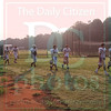 Matt Hamilton/The Daily Citizen<br /> CHS football players take the field as the sun rises Thursday morning.