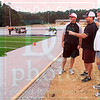 Matt Hamilton/The Daily Citizen<br /> From left, Preston Poag, Heath Patterson and Bill Mitchell look in on the progress at new Christian Heritage football field Saturday.
