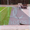 Matt Hamilton/The Daily Citizen<br /> Workers install the new turf at the Christian Heritage football field Saturday.