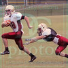 Matt Hamilton/The Daily Citizen<br /> Nich Bartly, left, runs for a Touchdown as he avoids the grasp of A.J. Hooper Friday.