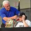 Matt Hamilton/The Daily Citizen<br /> Keith Lowe adjusts the hat of his son Austin Lowe Wednesday at CHS.