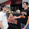 Matt Hamilton/The Daily Citizen<br /> Austin Lowe and Nich Bartley talk after the ceremony held in their honor at CHS Wednesday.