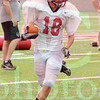 Matt Hamilton/The Daily Citizen<br /> Tyson Cooper looks for open turf after making a catch Saturday.