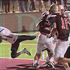 Matt Hamilton/The Daily Citizen<br /> D21 dives into the endzone to make the score 14-9 Friday.