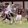 Matt Hamilton/The Daily Citizen<br /> CHS7 avoids the blitz and steps up into the pocket and makes a pass near the end of the game Friday.