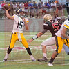Matt Hamilton/The Daily Citizen<br /> NM15 hurries to get a pass off before CHS55 can get to him Thursday.