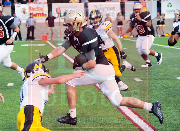 Matt Hamilton/The Daily Citizen<br /> CHS16 breaks a tackle by NM11 Thursday.