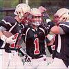 Matt Hamilton/The Daily Citizen<br /> CHS1 and CHS52 join CHS11 in the endzone after CHS11 caught a TD pass Thursday.