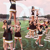 Matt Hamilton/The Daily Citizen<br /> NM cheerleaders lead the crowd in a cheer Thursday at Christian Heritage.