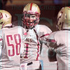 Matt Hamilton/The Daily Citizen<br /> CHS11 talks to his teammates after scoring a TD on a pass completion Friday.