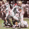 Matt Hamilton/The Daily Citizen<br /> CHS7 hops away from the grasp of a defender as he looks for running room Friday.