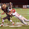 Matt Hamilton/The Daily Citizen<br /> C11 tries to run as MZ13 tackles him.