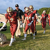 Matt Hamilton/Daily Citizen-News<br /> CHS players walk to the field before the start of the game on Thursday.