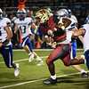 Matt Hamilton/Daily Citizen-News<br /> CHS3 bursts through the line on a carry.