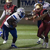 Matt Hamilton/Daily Citizen-News<br /> GC21 runs the ball as CHS33 attempts to tackle.