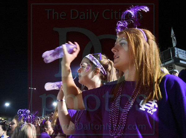 Matt Hamilton/Daily Citizen-News<br /> Ellis Herndon, 18, and Catherine Paige, 17, shake noisemakers and cheer on the Lions on Friday at Christian Heritage School.