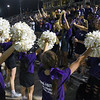 Matt Hamilton/Daily Citizen-News<br /> The Christian Heritage cheerleaders wear all purple as they lead the student section in a cheer on Friday.