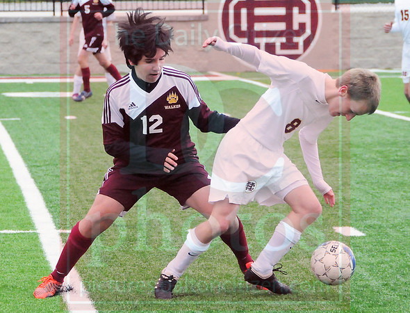 Matt Hamilton/The Daily Citizen<br /> CHS8 Ben Crawford and W12 R.J. Estrada battle for a ball Saturday.