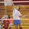 Matt Hamilton/The Daily Citizen<br /> Setter Katie Beth White looks on as Chelsea Elrod puts one over the net Thursday at Christian Heritage.