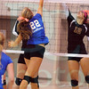 Matt Hamilton/The Daily Citizen<br /> N22 and C12 battle for a ball at the net Thursday.