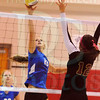 Matt Hamilton/The Daily Citizen<br /> NW22 puts a ball over the net as C12 defends Thursday.
