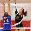 Matt Hamilton/The Daily Citizen<br /> C12 puts a ball over the net as N24 defends Thursday.