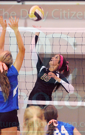 Matt Hamilton/The Daily Citizen<br /> C10 puts a ball over the net as N22 defends Thursday.