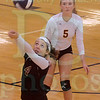 Matt Hamilton/The Daily Citizen<br /> CHS4 Rachel Gleaton returns a ball as CHS5 Brenna Mugge looks on Tuesday.