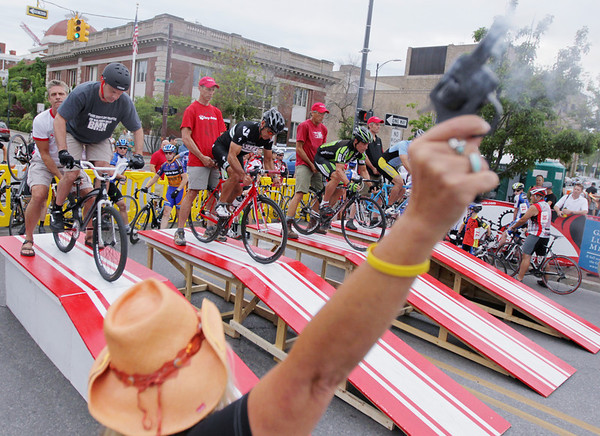 Record-Eagle/Keith King<br /> The starting gun fires at the beginning of a heat along Cass Street Friday, August 12, 2011 during the Cherry-Roubaix downtown bicycle sprints.