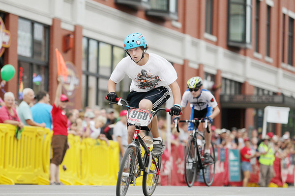 Record-Eagle/Keith King<br /> Jordan Newstead, 14, of Interlochen, races toward the finish line Friday, August 12, 2011 during the Cherry-Roubaix downtown bicycle sprints.