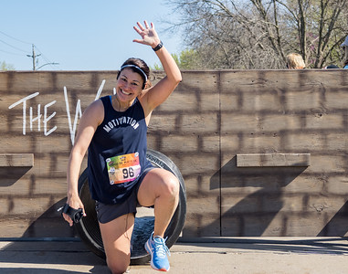 Jenn Paul crosses the finish at Ganzos Cinco de Mayo 5k