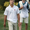 Round 2 of the Lowell City Golf Tournament, at Long Meadow Golf Club. Jack Koravos of Nabnasset reacts to a missed putt on the 18th hole. At rear is his caddy Patrick Nolan. (SUN/Julia Malakie)