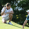 Round 2 of the Lowell City Golf Tournament, at Long Meadow Golf Club. Jack Koravos of Nabnasset, with caddy Patrick Nolan, waiting to putt at the 16th hole. (SUN/Julia Malakie)