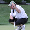 Round 2 of the Lowell City Golf Tournament, at Long Meadow Golf Club. Phil Smith of Long Meadow studies his putt at the 18th hole. (SUN/Julia Malakie)