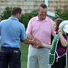 Round 2 of the Lowell City Golf Tournament, at Long Meadow Golf Club. From left, Ryan Friel and Danny Brown, both of Vesper, shake hands with Molly Smith, caddy for her father Phil Smith. (SUN/Julia Malakie)