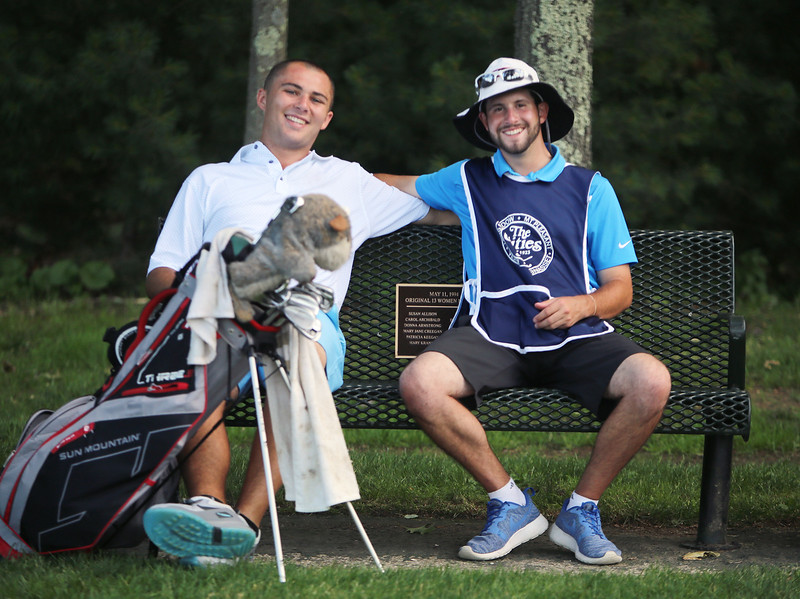 Day 1 of Lowell City Golf Tournament. Chris Gentle, right, caddies for Tom Connolly of Mt. Pleasant, who caddied for Gentle when he won the tournament last year. (SUN/Julia Malakie)