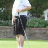 Day 1 of Lowell City Golf Tournament. Phil Smith of Longmeadow watches his putt on the 9th hole. (SUN/Julia Malakie)