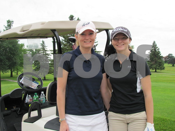 Deann Faiferlick and Kelsey Faiferlick pose before teeing off.