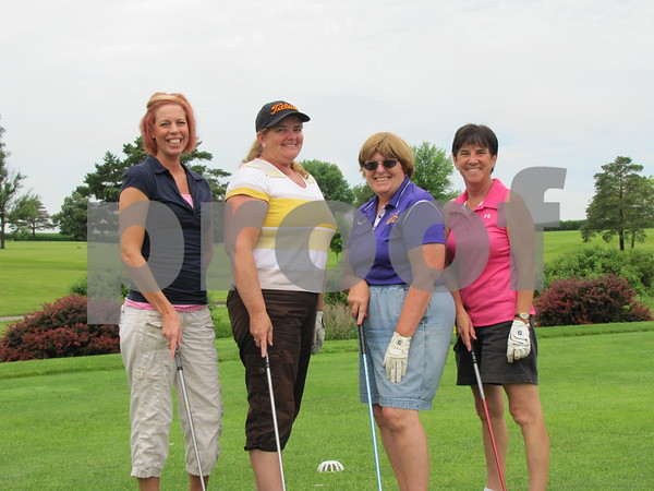 Alicia Taylor, Lois Ludwig, Jerilyn Maher, and Diane Blomker before tee off at the first hole at Lakeside.