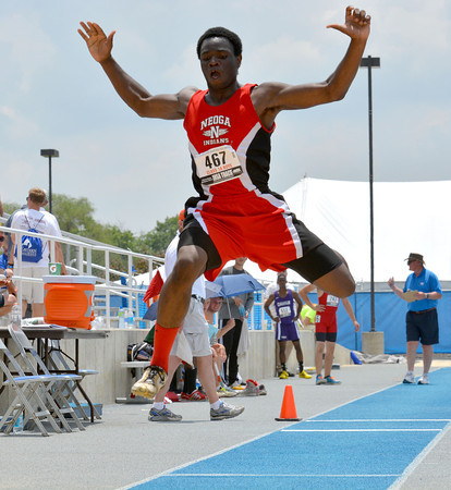 Neoga's Corey Kersey soars through the air with his limbs extended during an attempt in the triple jump, an event he would lead all state final qualifiers in at the Class 1A preliminary meet at Eastern Illinois University. Kersey is the state defending champ, and also qualified in the long jump with the top distance.